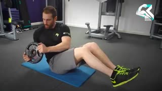 آموزش حرکت بدنسازی چرخش کمر با صفحه وزنه (شکم)